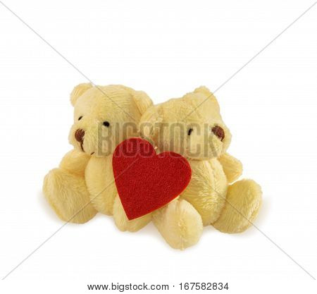 Two teddy bears with heart isolated over white. Valentine's Day and love concept.