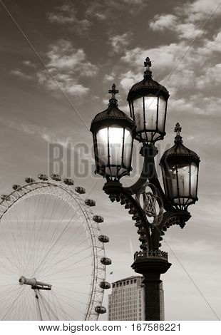 Vintage lamp post on Westminster Bridge in London in black and white.