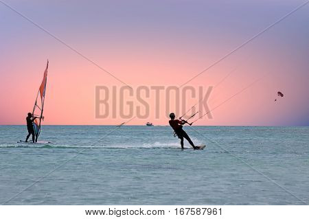 Watersport on the Caribbean Sea at Aruba island at sunset