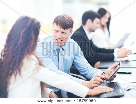 tax consultant is talking with the company accountant in the wor