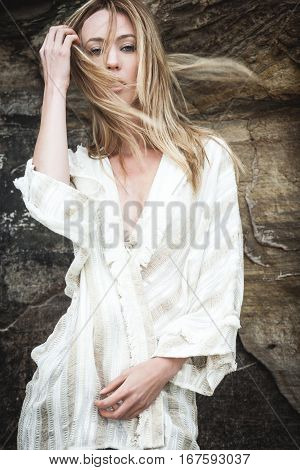modern lifestyle and fashion concept - young woman in casual clothes posing on a beach