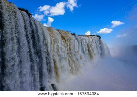 Close up view of cascading water of Iguazu Falls with bouncing mass of mist in Iguacu National Park, UNESCO World Heritage Site, Foz de Iguacu, Parana State, Brazil