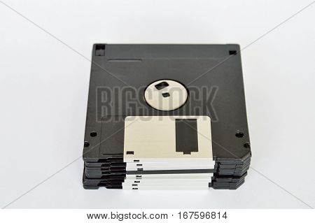black diskette overlay on the white background