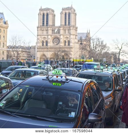 Paris, France, February 9, 2016: taxi on a parking in Paris, France