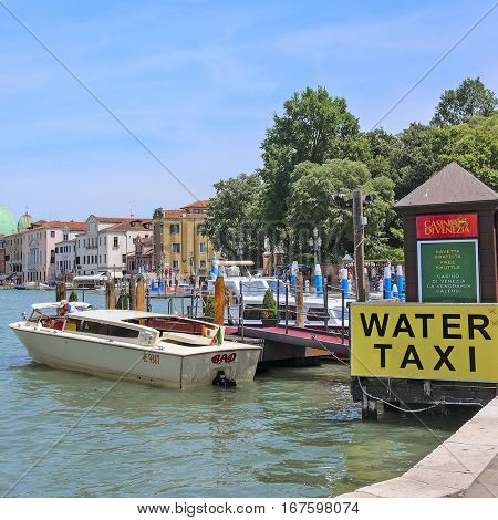 Venice, Italy, June, 21, 2016: the pier of water taxi in Venice, Italy. Water taxi is the popular kind of public transport in Venice, Italy