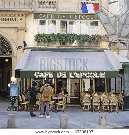 Paris, France, February 9, 2016: street cafe in Paris, France