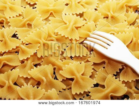 Heap of pasta in form of ribbons