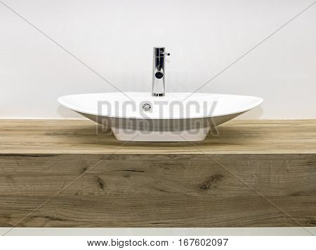 Ceramic Wash Basin at Wooden Counter in Contemporary Bathroom