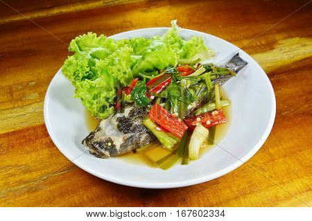 steamed sand goby fish with soy sauce on plate