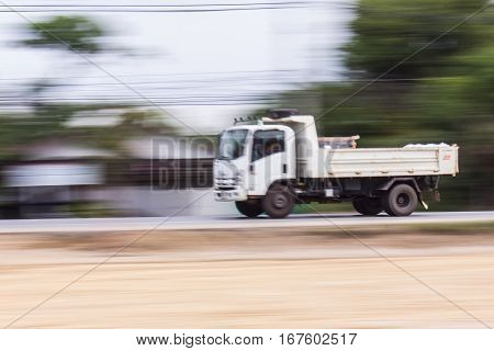 truck panning camera in road , speed