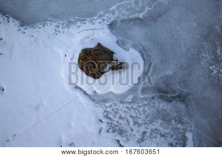 A rock frozen in Lake Michigan ice