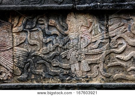 Ancient Mayan Mural Depicting A Warrior Holding A Human Head