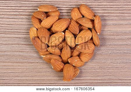 Heart Of Almonds On Wooden Background