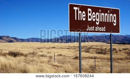 The Beginning Brown Road Sign