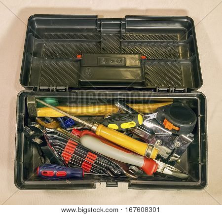 The black toolbox with the household on light background