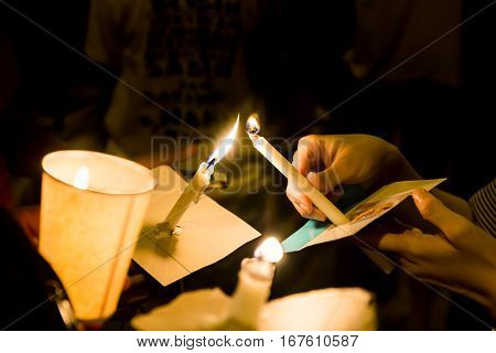 People Lighting Candle Vigil In Darkness Seeking Hope, Worship, Prayer