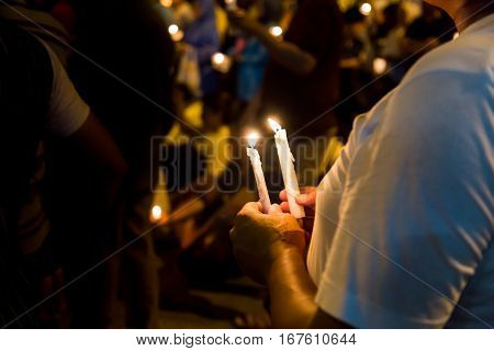 People Holding Candle Vigil In Darkness Seeking Hope, Worship, Prayer