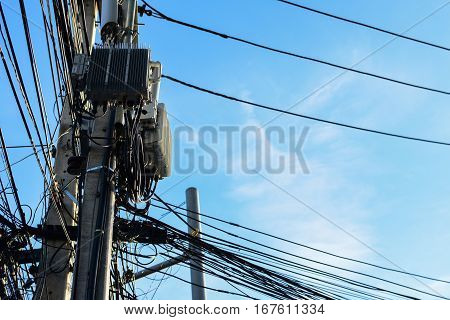 Cable clutter located on power poles,  electricity.