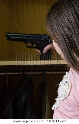 Young Girl Finds Gun In Closet