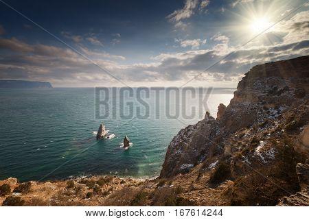 Seacoast under sky with clouds. Crimea. Russia