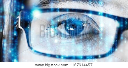 Digitally generated black and blue matrix against eye of a woman wearing spectacles