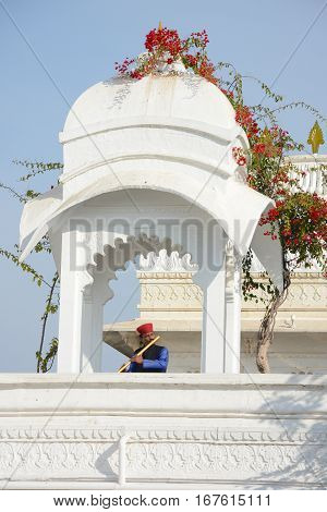 UDAIPUR INDIA - JANUARY 13 2017: Flute Player at the Taj Lake Palace Hotel. One of the most recognizable residences in the world was featured in the film Octopussy.