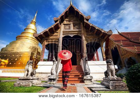 Woman Near Old Temple In Thailand