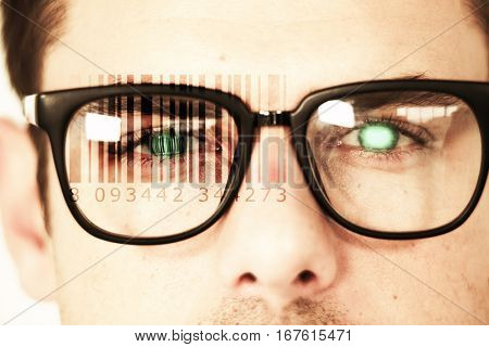 Composite image of Bar code against close up of man wearing spectacles
