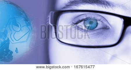 Digitally generated image of earth with social connectivity against eye of a woman wearing spectacles