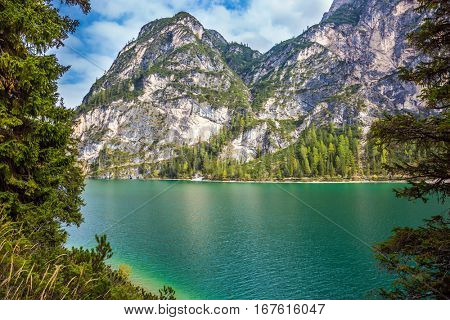 Walk around the picturesque lake Lago di Braies. Travel to South Tyrol, Italy. The concept of walking and eco-tourism
