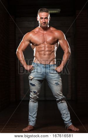 Man Showing Abdominal Muscle In Jeans