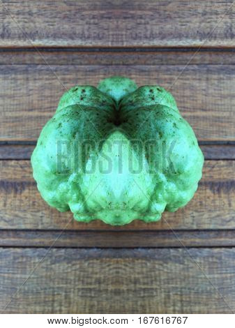 Fresh green guava fruit on wood background