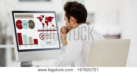 Composite image of business presentation with charts and text against rear view of businessman looking at computer monitor