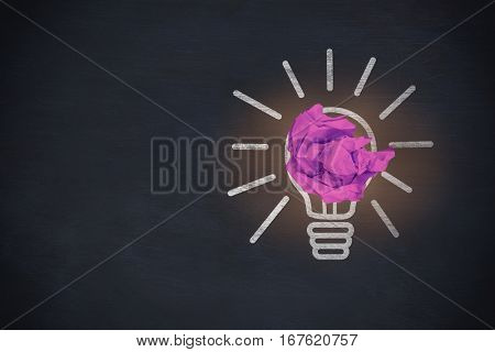 Purple crumpled paper ball against blackboard