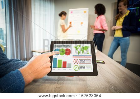 Digitally generated image of business presentation with charts and text against man showing digital tablet at office