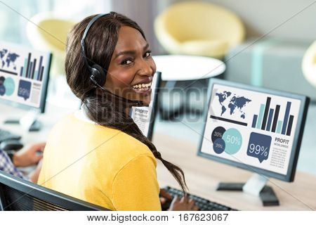 Computer graphic image of business presentation against woman smiling while using computer