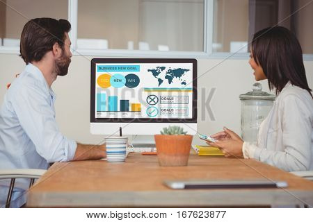 Computer graphic image of business presentation with charts and text against two colleagues having a video conference