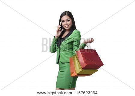 Beautiful Asian Business Woman Holding Shopping Bag While Talking On Her Mobile Phone
