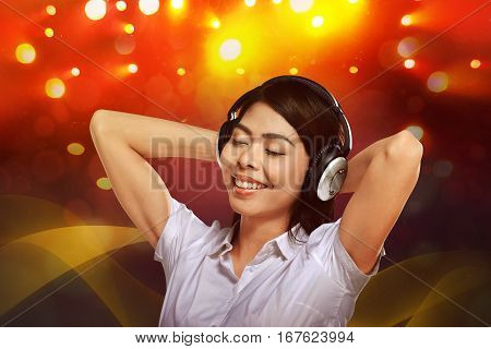 Young Asian Woman Enjoying The Music With Headphone