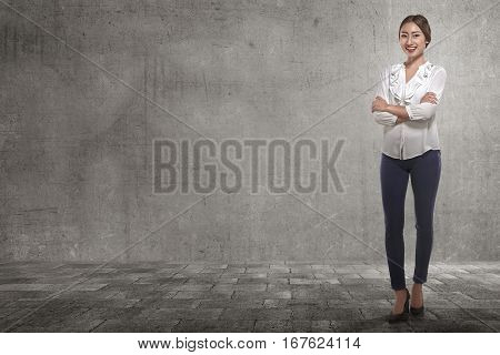 Smiling Asian Business Woman With Folded Arms In The Street