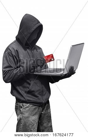 Hacker Man Wearing Anonymous Mask Holding Laptop And Credit Card While Standing