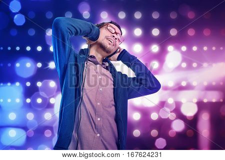 Stylish Asian Man In Headphones Listening To Music