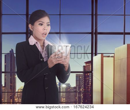 Beautiful Asian Business Woman Using Smartphone With Surprised Expression