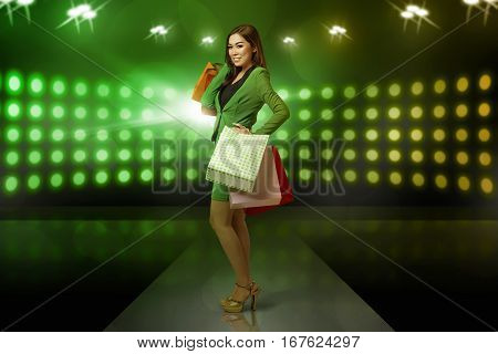 Young Asian Business Woman Standing With Shopping Bags