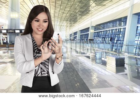 Beautiful Asian Business Woman Chatting On Her Mobile Phone While Standing