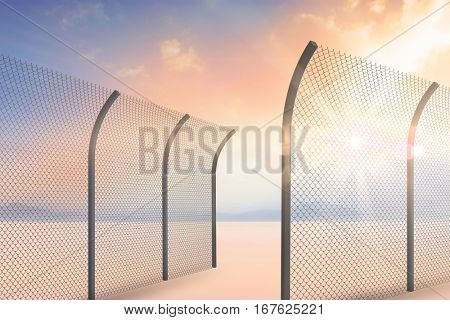 Bended chainlink fence against desert landscape 3d