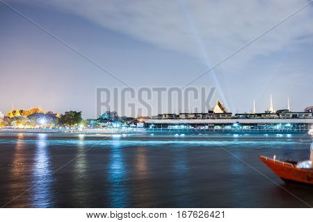 chao phraya river at night in bangkok thailand