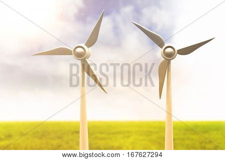 Illustration of wind mills against blue sky over green field 3d