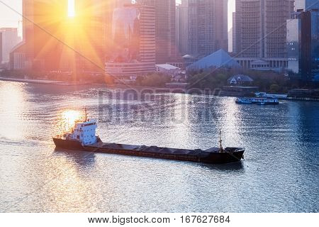 cargo ship sailing in huangpu river a spectacular view of shanghai scenery