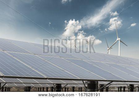 clean energy against a blue sky solar power plant and wind farm